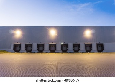 a large warehouse exterior with gates for dispatching goods