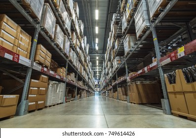 Large warehouse logistic or distribution center. Interior of warehouse with rows of shelves with big boxes  Distribution or delivery warehouse, logistics warehouse dispatch of goods