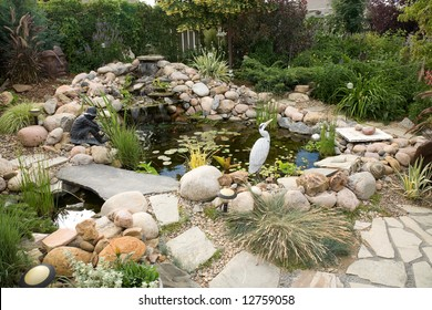 A large water feature turns a small backyard into a delightful summer retreat.