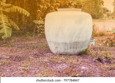 Large water jug used for water storage.