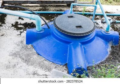Large water tank in the farmland.