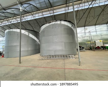 A large water tank inside a farm