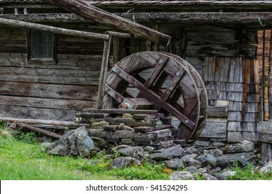 large water wheel made of wood at a hut in the mountains