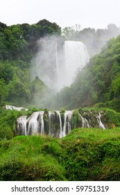 Large waterfall surrounded with green vegetation