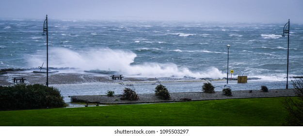 Large waves breaking the shore and a flooded road. Taken during Hurricane Ophelia in Salthill, Galway in 2017