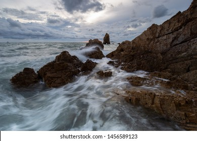 Large waves hit the rocks of