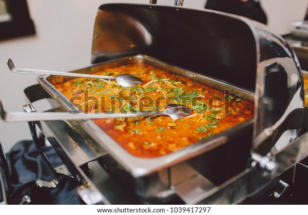 A large wedding buffet serving ethnic food