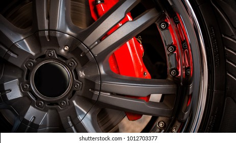 Large wheel rim with chrome and huge brakes with red caliper