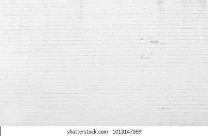 Large White Brick Wall. Abstract Brickwall Background Texture. Restoring Old Brick Wall Painted Whitewash. Grunge Wallpaper or Web banner With Copy Space For design