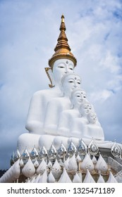 The large white buddha statue is located at Wat Phra That Pha Khok Kaeo with a sky background, a landmark of Phetchabun province. Thailand