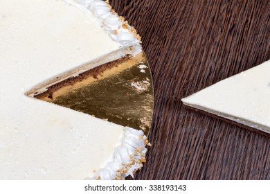 Large white cake with a piece cut off