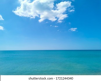 Large white clouds and blue-green waters
