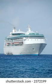 Large white cruise ship approaching port