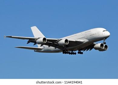 A large white double-decker passenger aircraft.