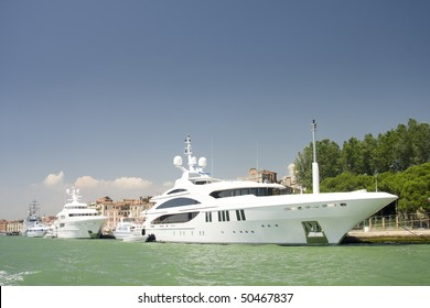 The large white luxurious yachts alongside the dock at Mediterranean Sea, Italy