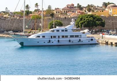 large white modern motor superyacht in the port city of Rhodes Greece