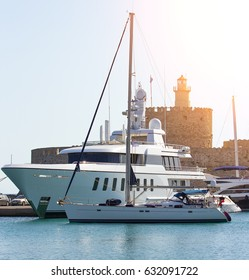 large white modern motor superyacht in port city of Rhodes Greece