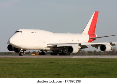 Large white plane prepares for takeoff from the airport