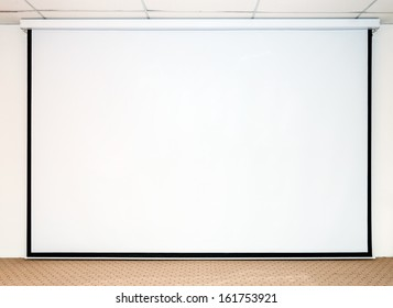 Large white screen for presentation on the stage.