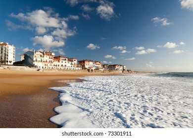 A large white water wave sliding on the Hossegor beach - France