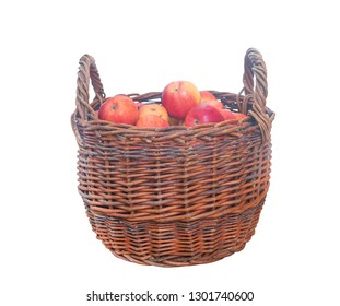Large wicker basket with apples on white background