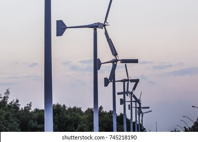 Large wind turbines are positioned side by side.