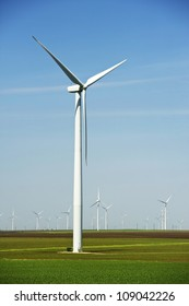 Large Wind Turbines Vertical Photography. American Midwest Landscape