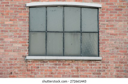 Large windows with thick brick wall