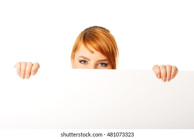 Large woman holding a white board