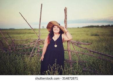 Large woman very happy in the meadow in vintage style