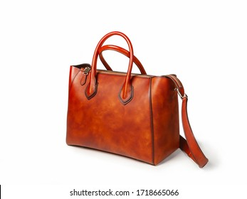 Large women bag made of brown leather, side view. The shoulder strap is visible on the right. Close up, isolated
