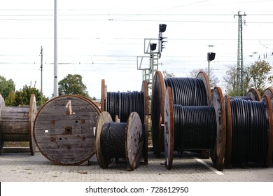 Large wooden cable pulleys with electric cables for rail transport / Cable reels