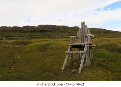Large Wooden chair at The Sorcerer's Cottage in West Fjords, Iceland