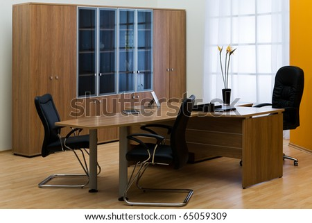 large wooden desk in a modern office