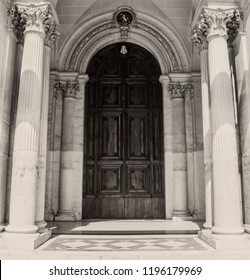 A large wooden door with Gothic stone works.