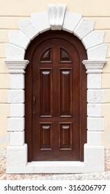 Large wooden door set in brick