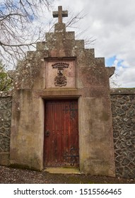 A large wooden studded Door set into a high stone wall, leading into a Walled garden on a property in Blairgowrie, Perthshire, Scotland