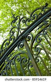 Large wrought iron gate at the entrance of a property in the countryside