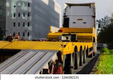 large yellow breakdown truck  parked along the road