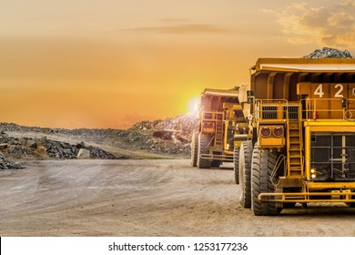 Large Yellow Dump Trucks transporting Platinum ore for processing
