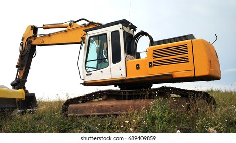 Large yellow excavator on a field