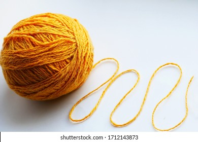 Large yellow tangle of yarn on a bright background close-up