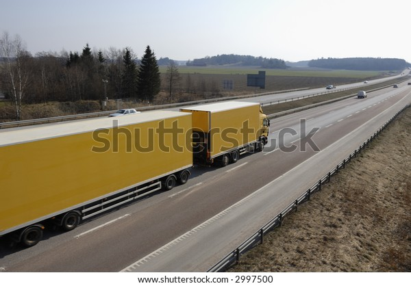 large yellow truck, lorry in early evening light