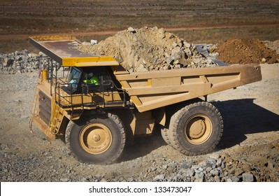 Large yellow truck used in modern Mine in Western Australia. Truck transports ore from the open cast mine.