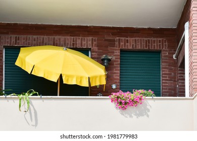 large yellow umbrella to shelter from the sun