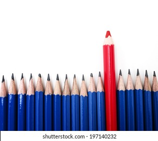 The larger, thicker red pencil stands out amongst the seventeen other smaller blue pencils.