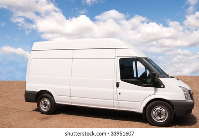 Larger white trade-van parked on red forecourt