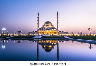 Largest Mosque in Sharjah beautiful traditional Islamic architecture new tourist attraction in Middle East evening shot of New Sharjah Mosque