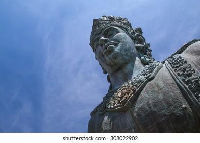 the largest Vishnu statue in GWK cultural park, Mandala Garuda Wisnu Kencana, or Garuda Wisnu Kencana, The famous tourist place in Bali, Indonesia. beautiful sky with copy space