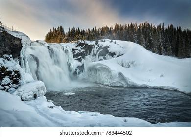 Largest waterfall of Sweden - Tannforsen. Winter look.